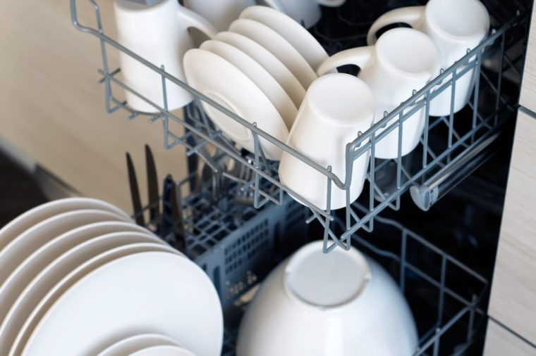 inside of dishwasher, close-up, slightly blue toned
