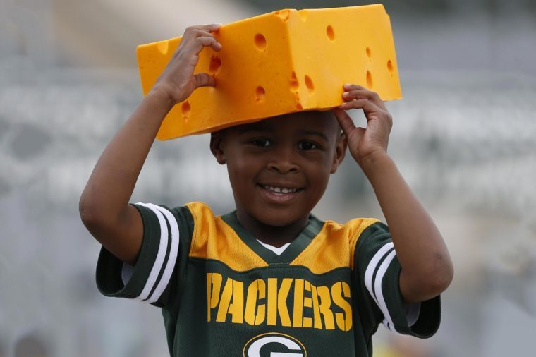 A fan wears a cheesehead before a preseason NFL football game between the Green Bay Packers and the Philadelphia Eagles, in Green Bay, Wis