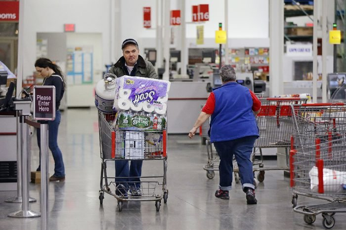 Tony D'Angelo walks away from the scan check out lane after completing his purchase using the BJ's Express Scan app on his cell phone while shopping at the BJ's Wholesale Club in Northborough, Mass. Like other automation technologies, scan-and-go shifts more of the work to shoppers while freeing up employees for higher-value tasks. That's especially critical as stores look for ways to make their workers more efficient as they wrestle with rising wages