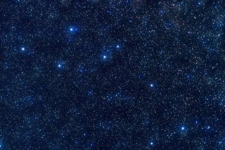 Delphinus (Dolphin) constellation: astronomy photo. Exposure 780 sec. Star field around Delphinus with variegated stars and dark nebulae and other deep space objects. Can be used as a walpaperl