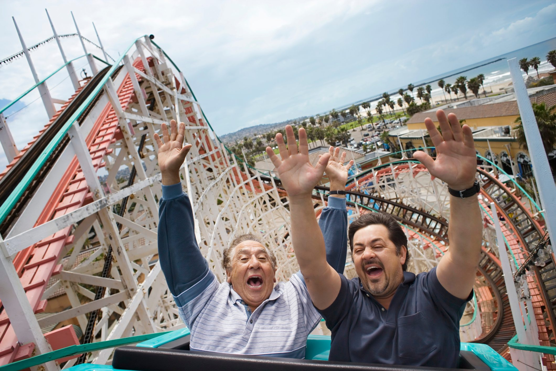 father and son riding roller coaster on Father's Day