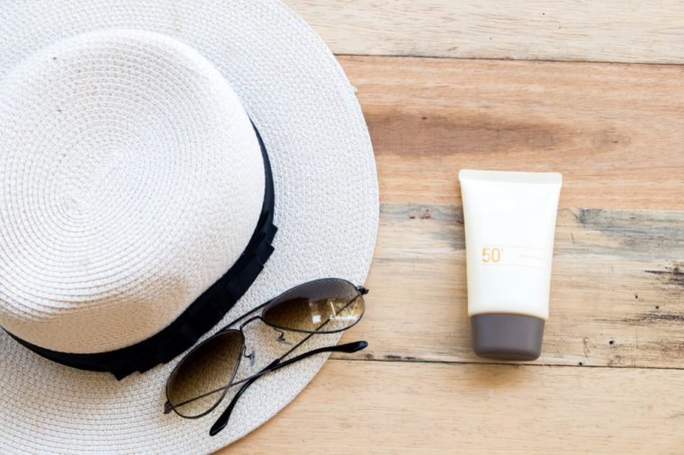 natural cosmetic for skin face sunscreen spf 50 of woman with accessories for lifestyle woman relax