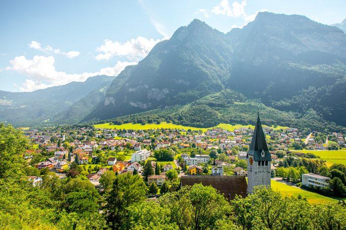 Landscape view on Balzers village with saint Nicholas church in Liechtenstein