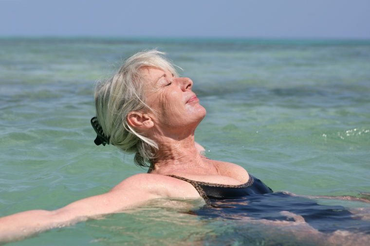 Portrait of a senior woman bathing in the sea