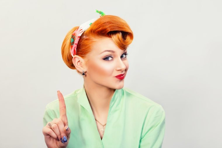 woman gesturing a no sign. portrait unhappy, serious pinup retro style girl raising finger up saying oh no you did not do that white grey background. Negative emotions, facial expressions, feelings