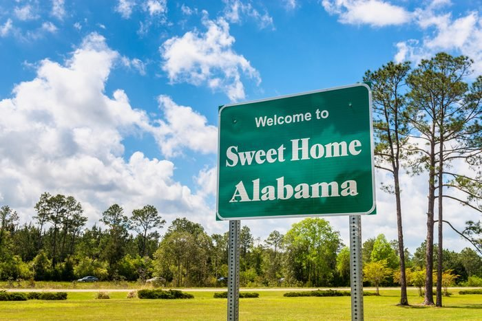 Welcome to Sweet Home Alabama Road Sign along Interstate 10 in Robertsdale, Alabama USA, near the State Border with Florida