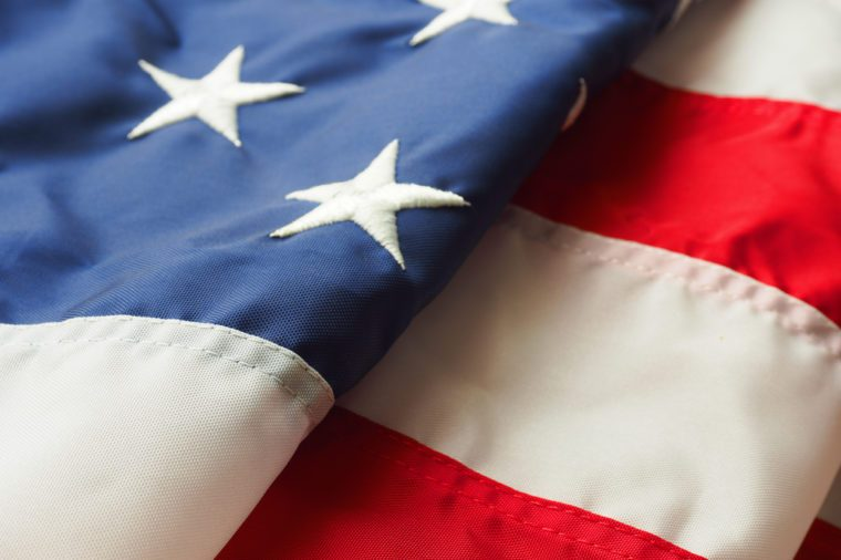 Detail of a partial folded American flag using as background