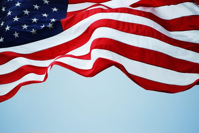 An American flag flowing in the wind.