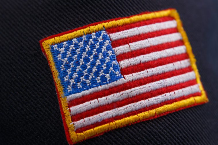 US flag patch on black background, close up