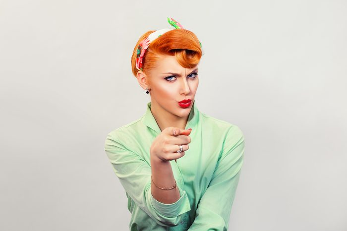 It's you! Portrait angry annoyed pin up retro style woman getting mad pointing finger at you camera showing hand gesture this is you, you chosen, isolated on grey wall background. Negative emotions