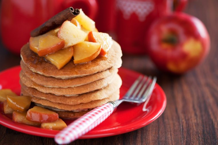 Pancakes with cinnamon and caramelized apples, selective focus