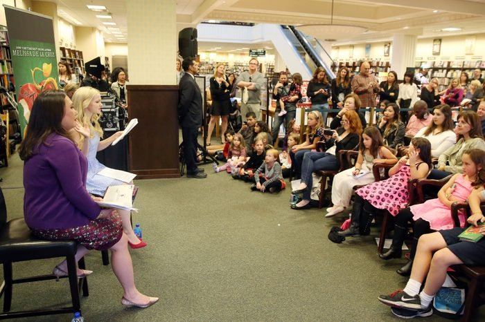 """Author Melissa de la Cruz, left, and Dove Cameron, star of the Disney Channel original series """"Liv and Maddie"""" and Disney's """"Descendants"""", are seen at the book launch event for """"The Isle of the Lost: A Descendants Novel"""" at Barnes & Noble, on in Los Angeles"""
