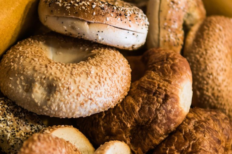 Close up of assorted bagels and croissants.