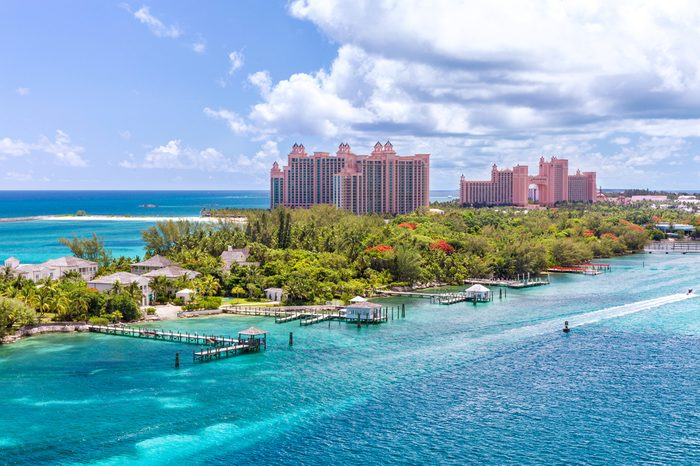 Paradise island with the Atlantis Resort at the background, Nassau, BahamasAwesome Atlantis Resort on Paradise island in the island of Nassau, in the heart of the Caribbean sea in a sunny summer day.