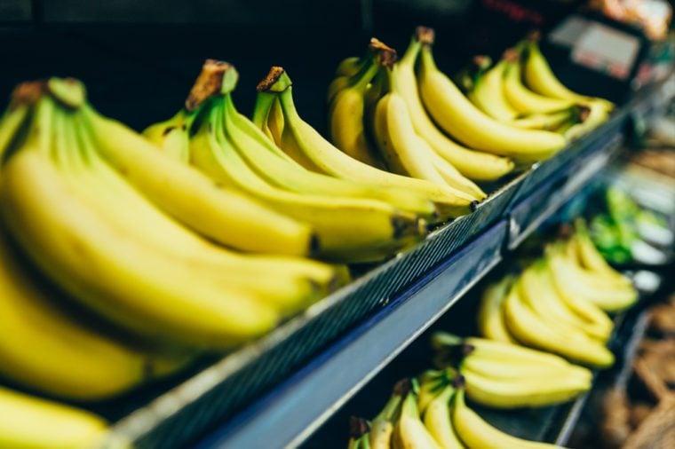 yellow bananas on store shelf. fruits grocery shopping
