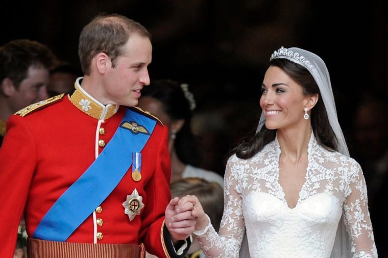 Britain's Prince William and his wife Kate, Duchess of Cambridge stand outside of Westminster Abbey after their Royal Wedding in London Friday, April, 29, 2011