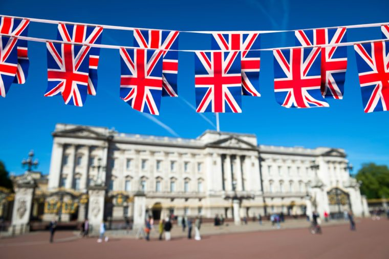 Union Jack flag bunting decorates the Mall in front of Buckingham Palace ahead of the Royal Wedding in London, England.