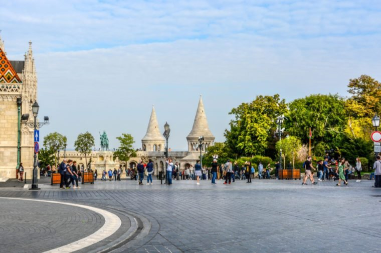 Budapest, Hungary - September 26 2017: Matthias Square with the Matthias Church and the Fisherman's Bastion with tourists enjoying the sunny day in Budapest Hungary