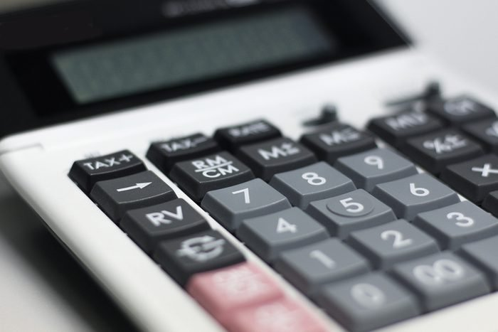 Close up button calculator , calculator on table