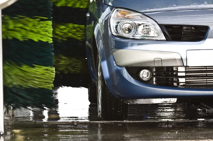 Blue car during washing process