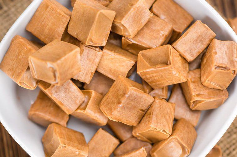 Caramel on a vintage background as detailed close-up shot (selective focus)