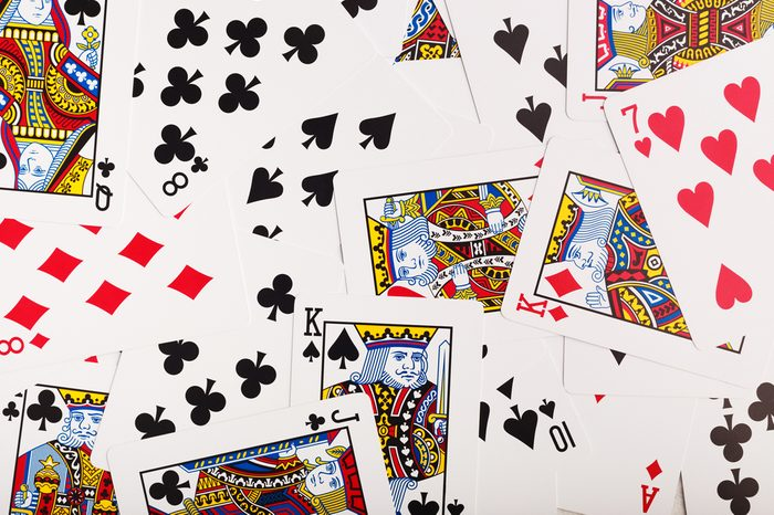 Pile of poker card texture. Casino cards as background.