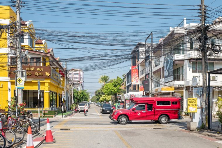 CHIANG MAI, THAILAND - FEBRUARY 3: Iconic traditional red truck taxi roames the streets on February 3, 2016 in Chiang Mai. Chiang Mai is a major tourist destination in northern Thailand