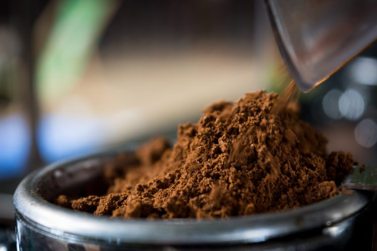 Coffee while grinding in a coffee machine grinder
