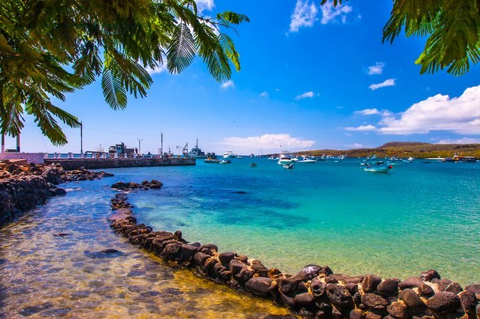 The bay with a dock in the Galapagos Islands. Pacific Ocean. Ecuador. The Galapagos Islands. Isla San Cristobal Island