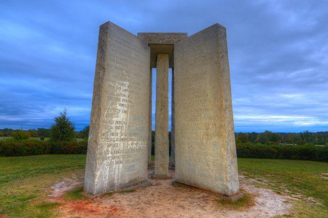 "ELBERT, GEORGIA - OCTOBER 12: The Georgia Guidestones, occasionally referred to as ""American Stonehenge"" October 12, 2011 in Elbert, GA. The inscription is of 10 principles in 8 different langauges."