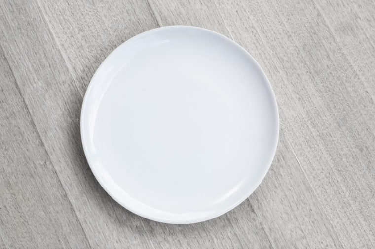 white Empty plate on old wooden background. Top view with copy space