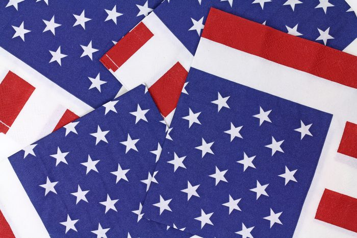 Several red white and blue napkins in the same color as the American flag.