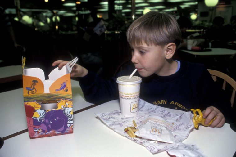 MODEL RELEASED Boy eating McDonalds happy meal UK
