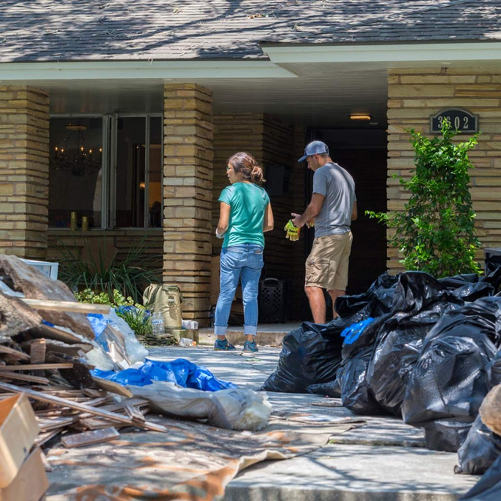 Houston, Texas - August 31, 2017: Cleanup begins in Houston after hurricane Harvey and heavy floods. A family moves belongings from their flooded home in Houston, Texas
