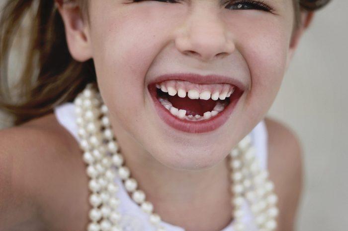 little girl loses her baby teeth