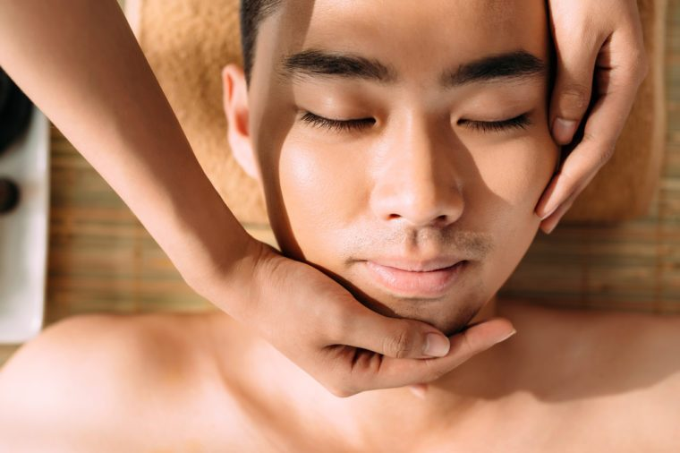 Close-up of man enjoying professional facial massage