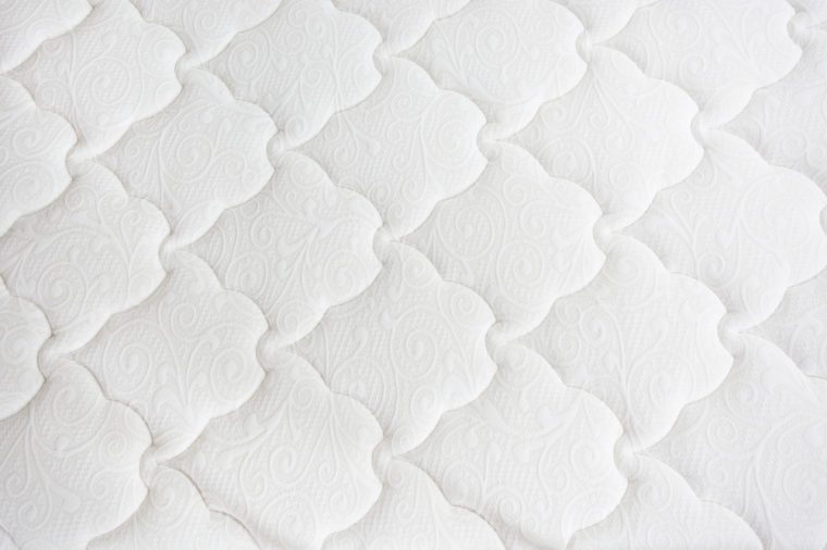 White background from textile. Texture, abstract pattern. Top view.