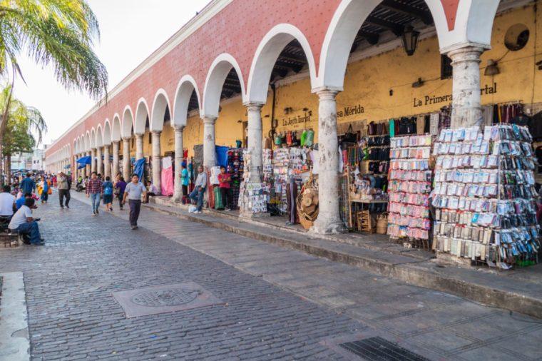 MERIDA, MEXICO - FEB 27, 2016: Shops under a archway in Merida, Mexico