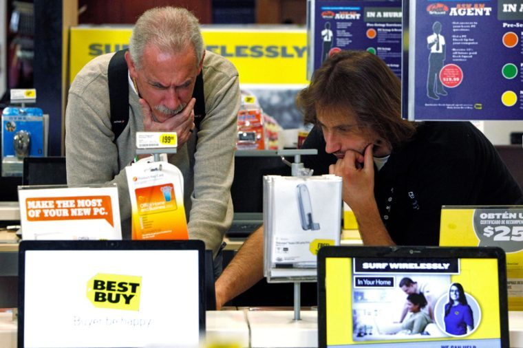 Michael O'Neil, Ara Gregorian Customer Michael O'Neil, left, is assisted by Best Buy sales associate, Ara Gregorian, as he shops for a laptop computer at Best Buy store in Glendale, Calif., . Shoppers shrugged off higher gas prices and cool temperatures to give retailers a surprisingly strong March