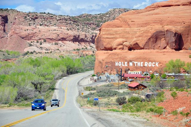 """MOAB, UTAH, USA - APRIL 19, 2014 : Hole N"""" The Rock, a most unique home, carved out of a huge rock. This historic 5,000 square foot home and unusual gift shop and trading post are open all year."""