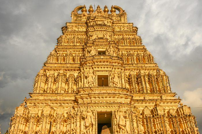 MYSORE, INDIA - OCTOBER 11: Hindu Temple at main gateway entrances to Mysore maharaja's Palace or Amba Vilas in city of Mysore Palace on October 11, 2016 Karnataka, South India. Ancient Indian temple.