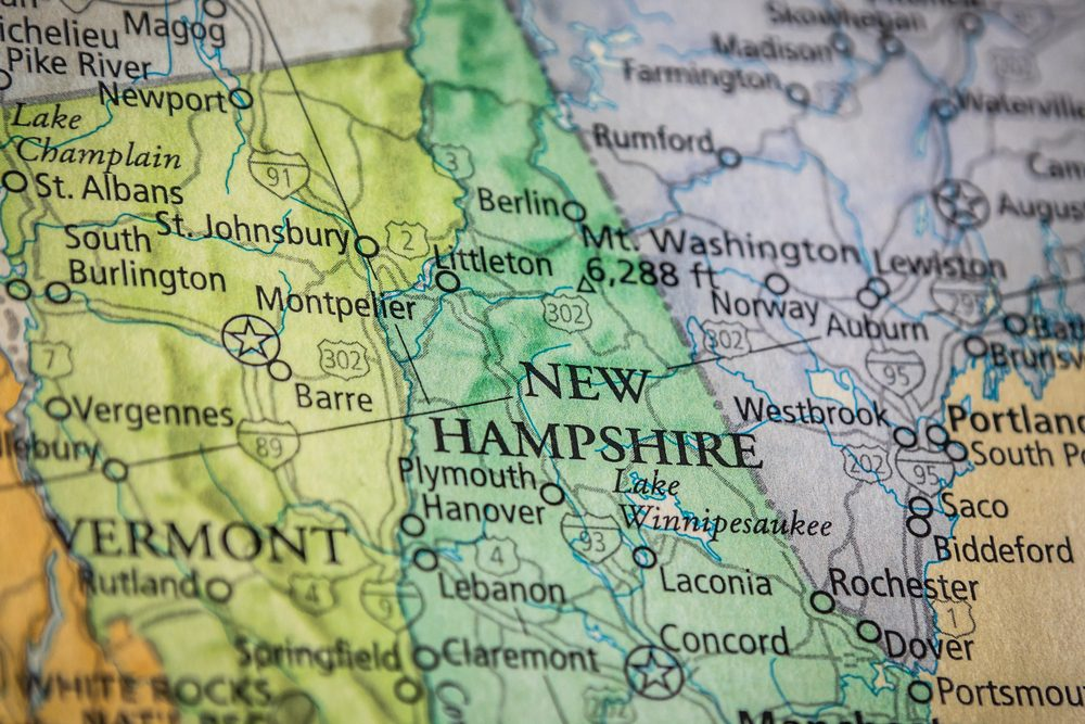 Closeup Selective Focus Of New Hampshire State On A Geographical And Political State Map Of The USA.