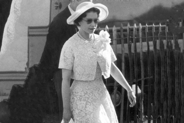 Queen Elizabeth II Arrives At Windosr Cocktail Party 1959 Queen Wearing A Lemon Lace Two-piece Wide-rimmed Hat And Sun Glasses Arrives At Smith's Windsor Great Park Last Night For A Cocktail Given By The 1stf Bn. The Irish Guards. It Was The Climax Of A Great Day. First There Was Ascot Where The Queen Saw Her Horse Above Suspicion Win The Last Race. Then There Was A Polo Match In Windsor Great Park Where The Queen Saw Prince Philip Play For Windsor Park Against Windsor Park.