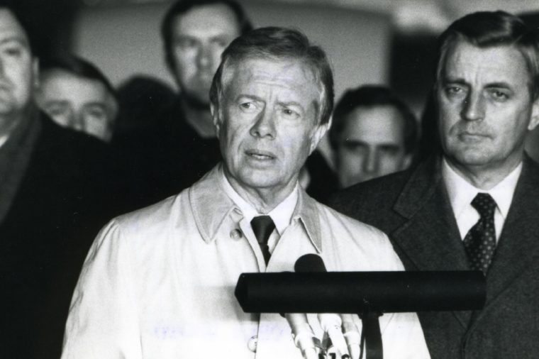 Rhein-main Air Base, West Germany, January 1981 - The 52 Freed Hostages, After Their Release From Iran, And Former Vice-president Walter Mondale Listen As Former President Jimmy Carter Speaks To A Crowd
