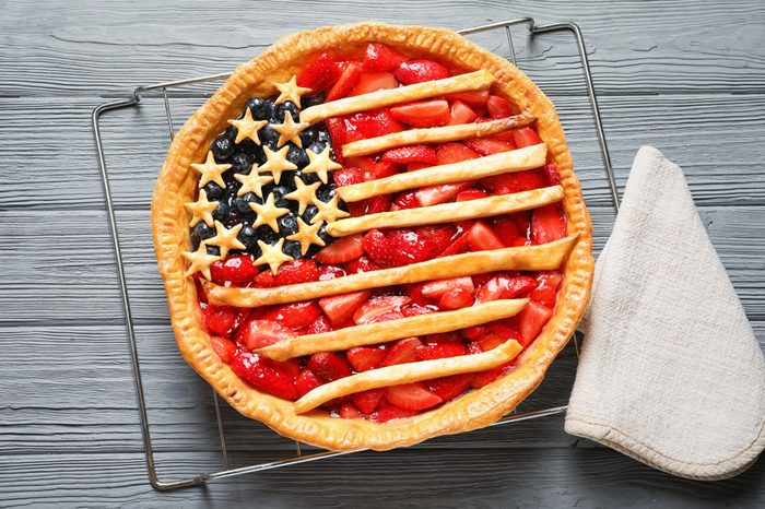 Tasty American flag pie on wooden table