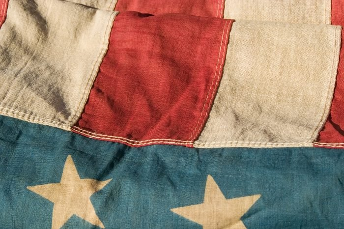 close up of a section of an antique american flag