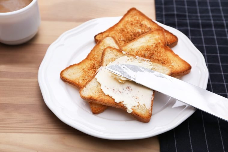 Toasted bread served with butter on plate