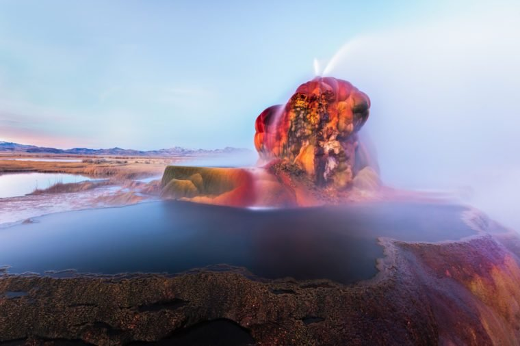 Fly Geyser near the Black Rock Desert in Nevada constantly erupts minerals and hot water creating bright colors and terraced pools.