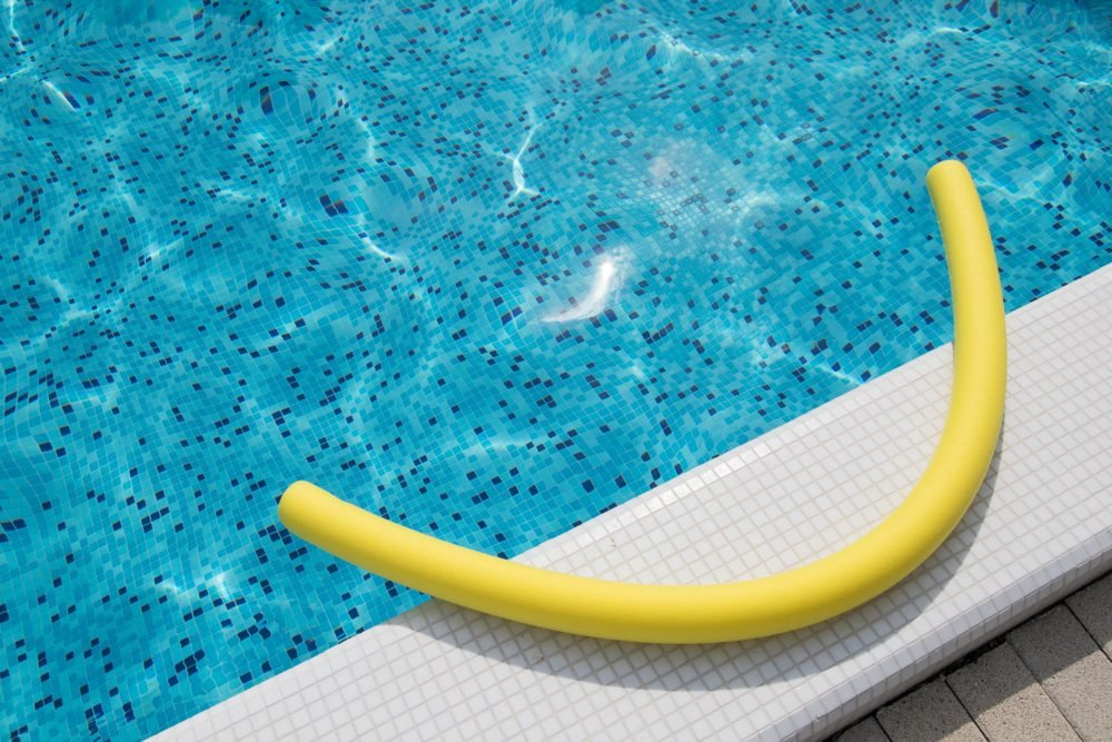 Yellow noodle in the swimming pool outdoor