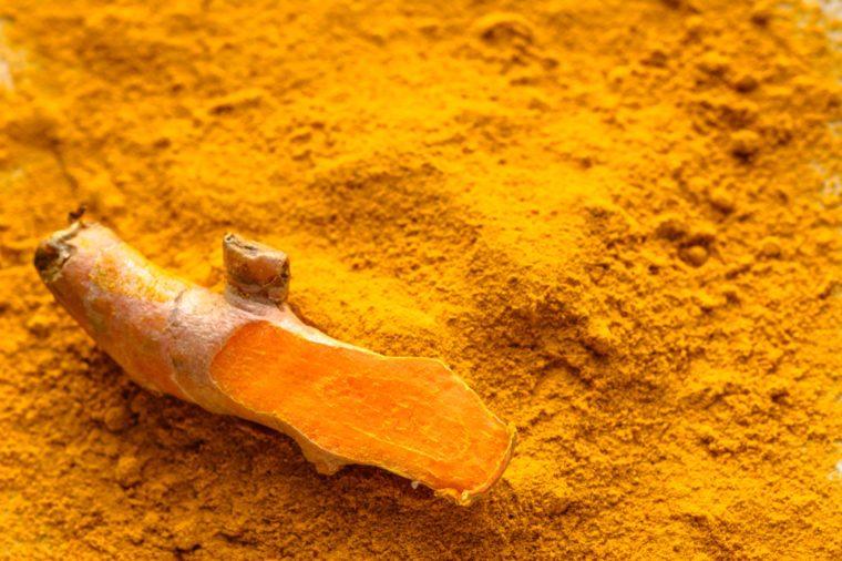 Fresh root and turmeric powder, indian spice, healthy seasoning ingredient for vegan cuisine